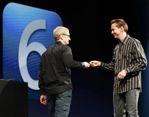 Scott Forstall, senior vice president of iOS Software at Apple Inc. (R), hands off the remote to Apple CEO Tim Cook during the Apple Worldwide Developers Conference 2012  in San Francisco