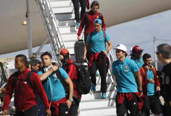 Portugal's Ronaldo arrives with his team mates at the Viracopos airport ahead of the 2014 World Cup in Campinas