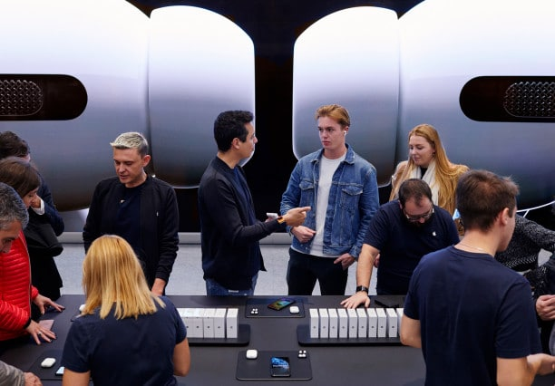 Apple-AirPod-Pro-launch-Milan-guests-at-product-table-10302019