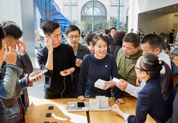 Apple-AirPod-Pro-launch-Shanghai-guests-with-team-member-at-product-table-10302019